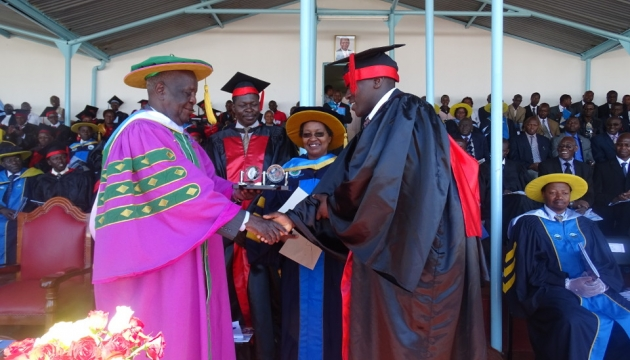 Mr. Rotich receiving best research award from UoK Chancellor